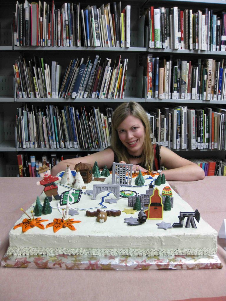 Erin Gee with Mind the Gap cake, opening reception, Dunlop Art Gallery, Regina, SK, 2009