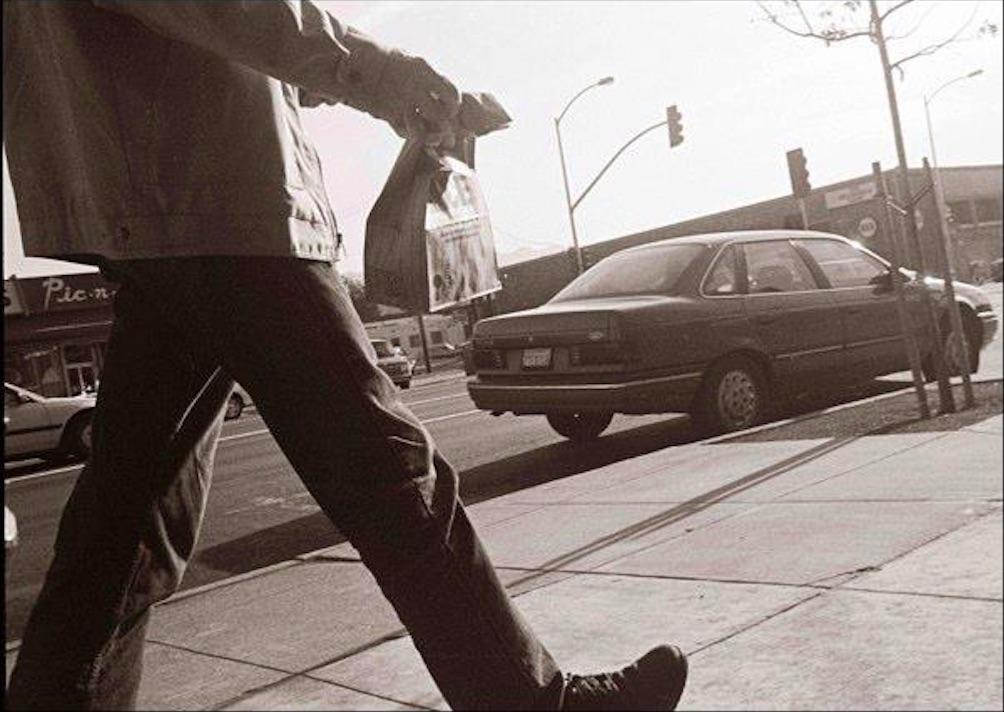 "Ricardo Gil, Walking Man and Paper Bag, c. 1999, giclée print, 16 x 20"" (framed)"