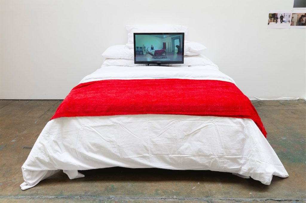 Liz Crow, Bedding Out, 2013, Video. 8:57, installation with bed