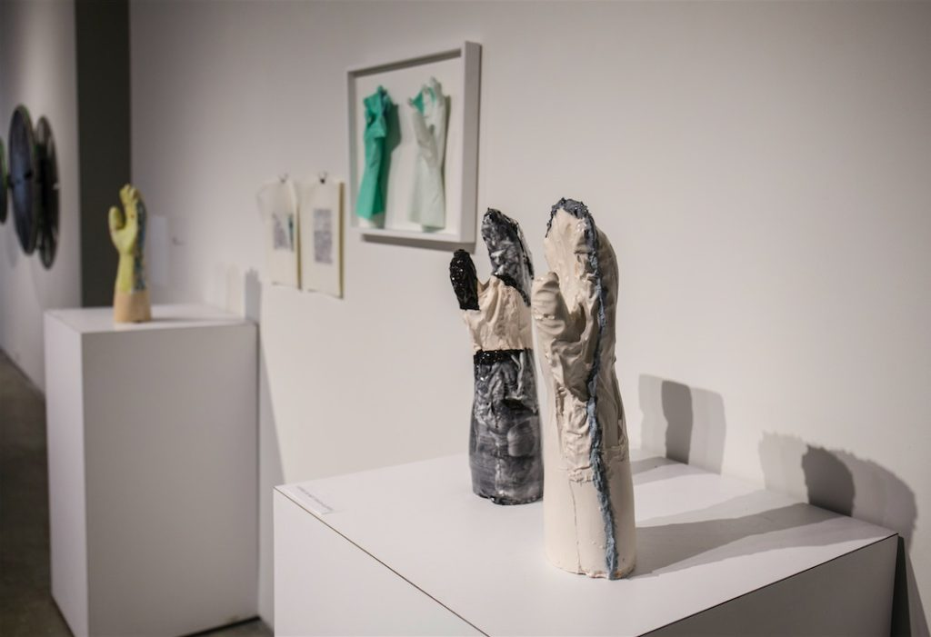 Funda Susamoglu, Handmade, 2013, Mixed media installation (ceramics, rubber gloves, paper), each ceramic piece is 16 x 6 x 4.7""